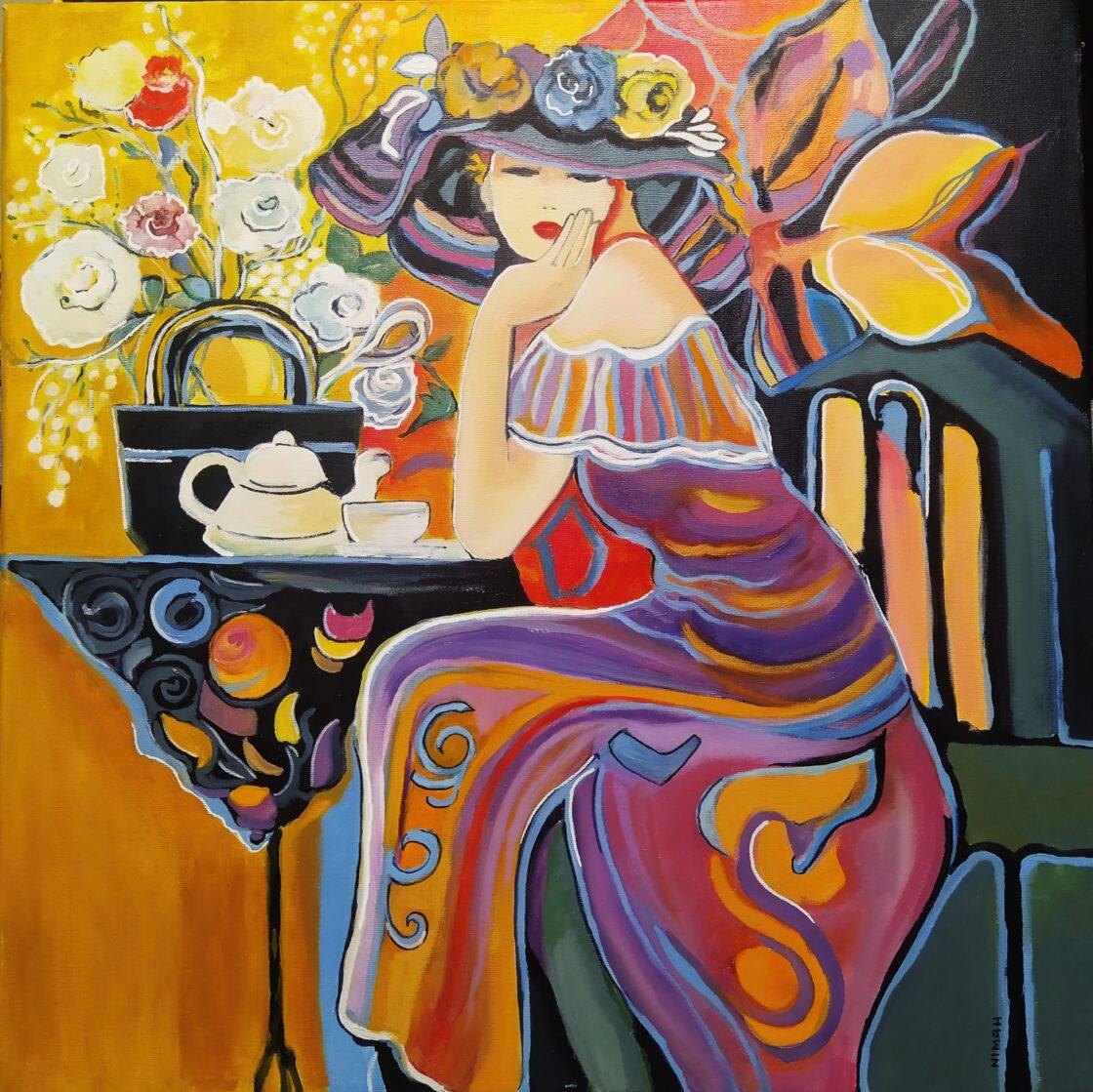 donna seduta al caffè